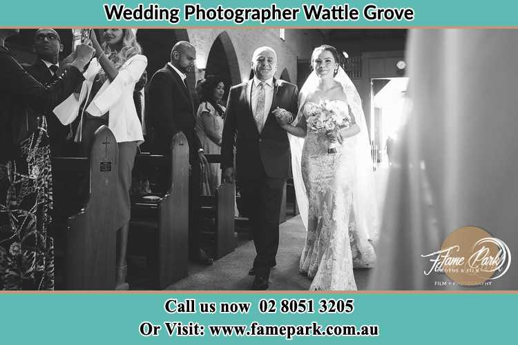 Photo of the Bride with her father walking the aisle Wattle Grove NSW 2713