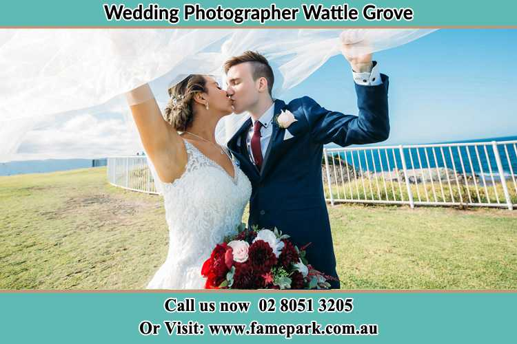 Photo of the Bride and the Groom kissing at the yard Wattle Grove NSW 2713