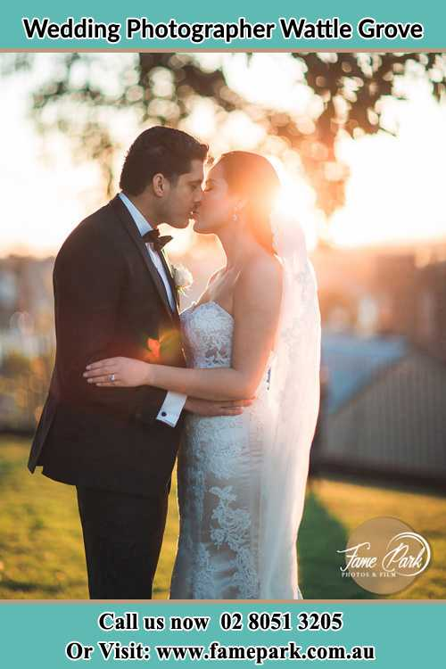 Photo of the Groom and the Bride kissing at the yard Wattle Grove NSW 2713