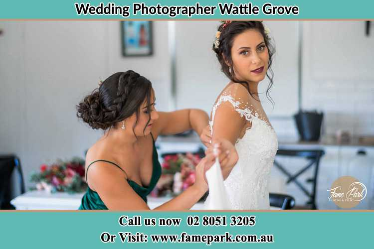 Photo of the Bride and the bridesmaid getting ready Wattle Grove NSW 2713