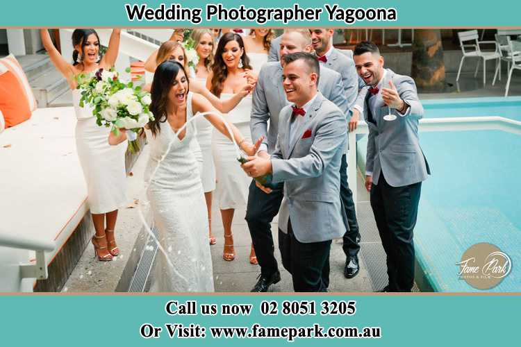 Photo of the Groom and the Bride celebrating with the secondary sponsors Yagoona NSW 2199